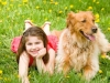 Little Girl Laying Down With Dog